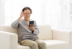 senior woman touching the smart phone Stock Images