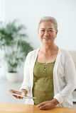 Senior woman with touchpad Stock Photography