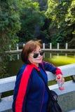 Senior women tourist stand beside the Lake on top of the xiqiao mountain. Senior woman tourist stand beside the Lake on top of the xiqiao mountain foshan city stock photography