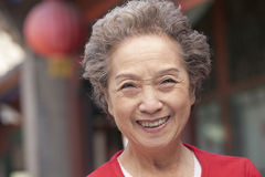 Senior Woman in Traditional Chinese Courtyard Royalty Free Stock Image