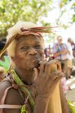 Senior woman traditional costumed, nature material, Solomon Islands, South Pacific Ocean. Elderly woman with nearly white hair, costumed from natural material Royalty Free Stock Photography
