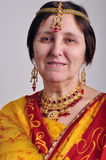 Senior woman in traditional Indian clothing and jeweleries Stock Image
