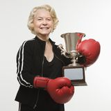 Senior woman with trophy stock image
