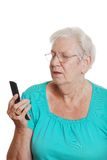 Senior woman trying to use a cell phone Stock Photos