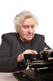 Senior woman with typewriter Stock Photography