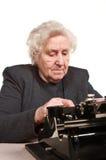 Senior woman with typewriter stock photography