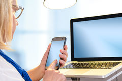 Senior woman typing on blank smart phone. Stock Photo