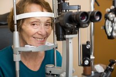Senior Woman Undergoing Eye Examination Stock Photos