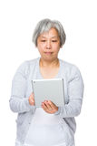 Senior woman use of tablet pc Royalty Free Stock Photography