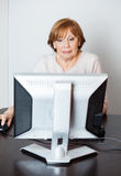 Senior Woman Using Computer In Class Stock Images