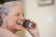 Senior woman using cordless phone, laughing, close-up, side view Stock Photos