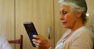 Senior woman using digital tablet 4k stock footage