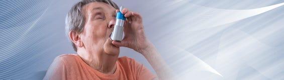 Senior woman using an inhaler. panoramic banner royalty free stock photography
