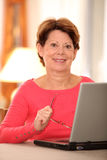 Senior woman using internet Royalty Free Stock Photo