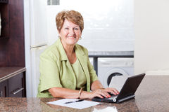 Senior woman using laptop Royalty Free Stock Image