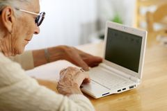 Senior woman using laptop royalty free stock photography