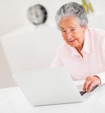 Senior woman using a laptop Stock Photos