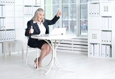 Senior woman using laptop Stock Photo