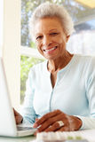 Senior Woman Using Laptop At Home Stock Photos