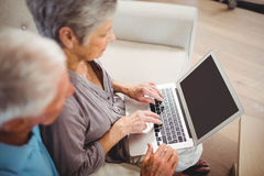Senior woman using laptop in living room Stock Photography