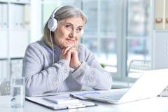 Senior woman  using laptop Stock Images