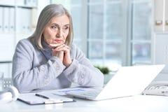 senior woman using laptop Stock Photos