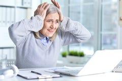 Senior woman using laptop Royalty Free Stock Photo