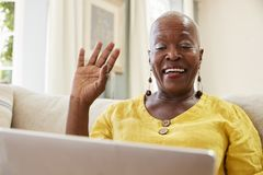 Senior Woman Using Laptop To Connect With Family For Video Call royalty free stock photo