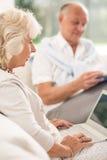 Senior woman using laptop Royalty Free Stock Images