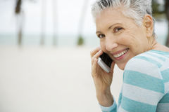 A senior woman using a mobile phone Stock Images