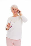 Senior woman using mobile phone Royalty Free Stock Photos