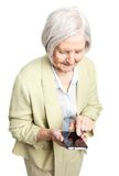 Senior woman using mobile phone over white Royalty Free Stock Images