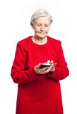 Senior woman using mobile phone over white Stock Image