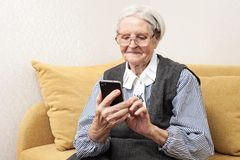 Senior woman using mobile phone Stock Photo