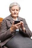 Senior woman using mobile phone Royalty Free Stock Photos