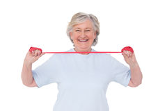 Senior woman using resistance band Stock Photography