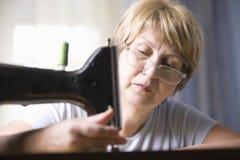 Senior Woman Using Sewing Machine Stock Image