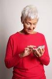 Senior woman using smartphone Stock Image