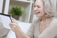 Senior Woman Using Tablet Computer Stock Image