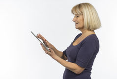Senior woman using a tablet computer Stock Photos
