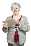Senior woman using tablet computer smiling Royalty Free Stock Image
