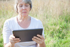 Senior woman using tablet device Stock Photography