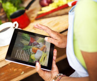 Senior woman using tablet in her kitchen Royalty Free Stock Images