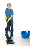 Senior woman using vacuum cleaner Royalty Free Stock Photography