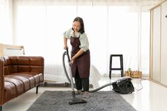 Free Senior Woman Using Vacuum Cleaner At Home Stock Photos - 214955433