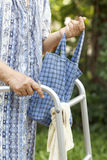 Senior woman using a walker Stock Image