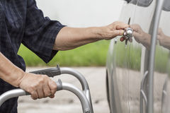 Senior woman using a walker at car park Royalty Free Stock Image
