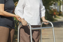 Senior woman using a walker cross street Stock Photography