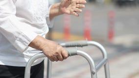 Senior woman using a walker cross street. stock video footage
