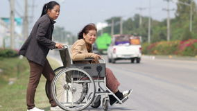 Senior woman using a walker cross street stock footage